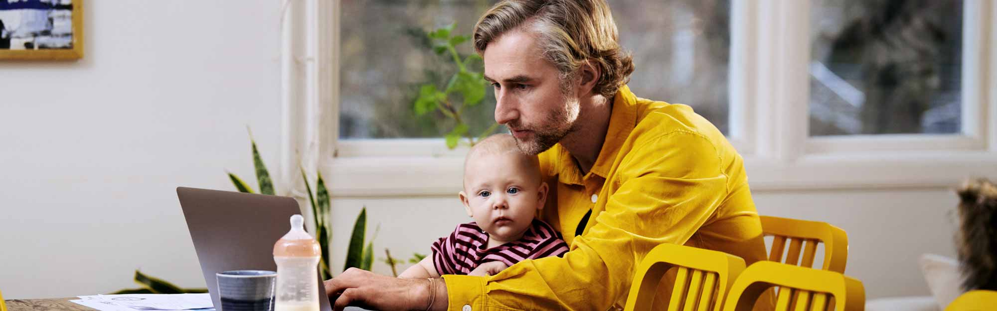 Father and baby with a laptop